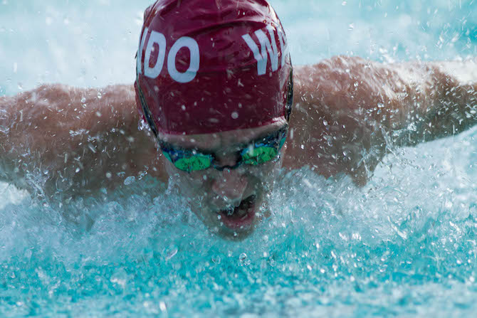 Sophomore+Davis+Caldwell+races+in+the+100+butterfly.
