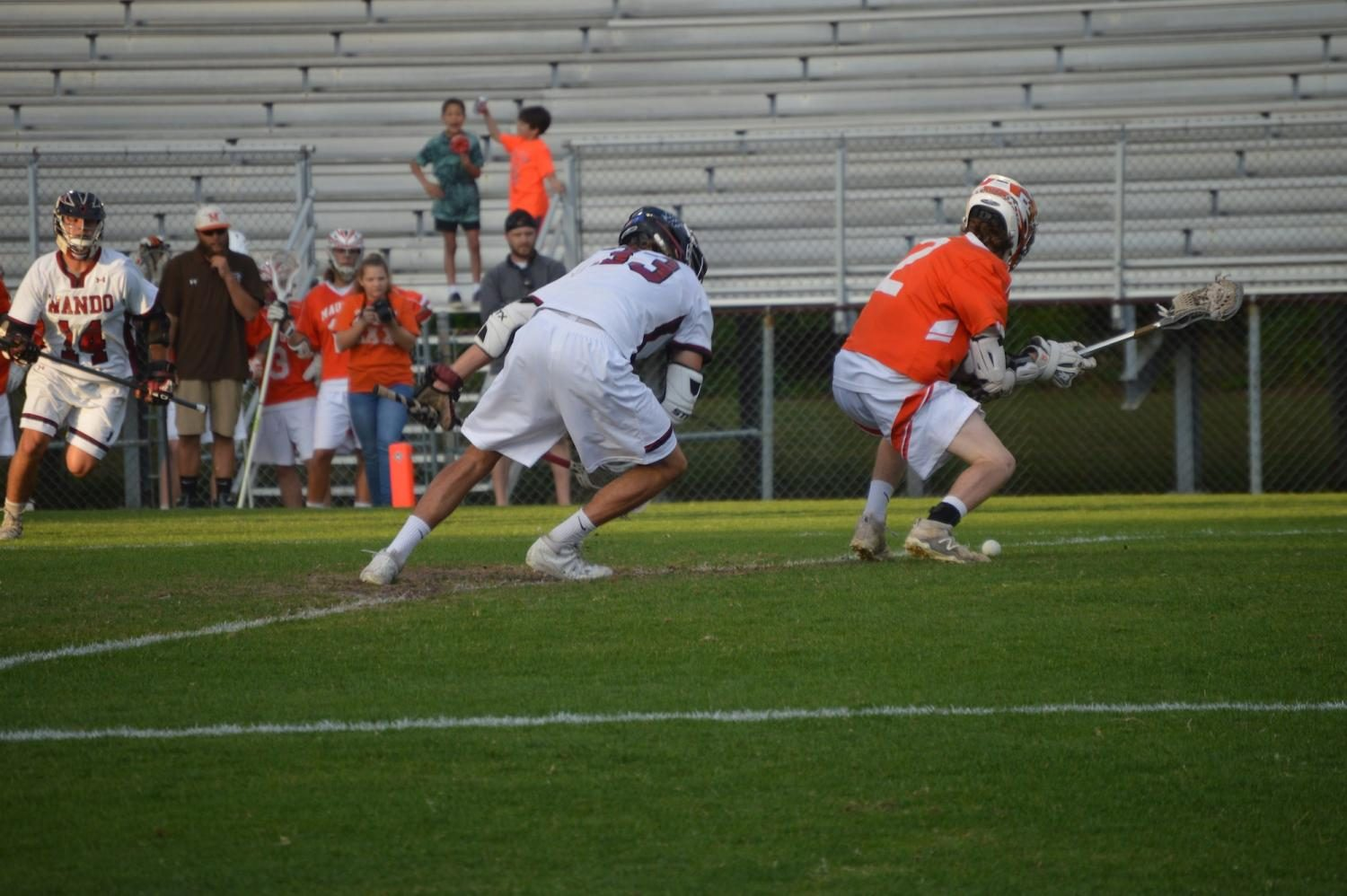 Senior Cole Hartley #33 competes for possession of the ball during their game against Mauldin on April 25