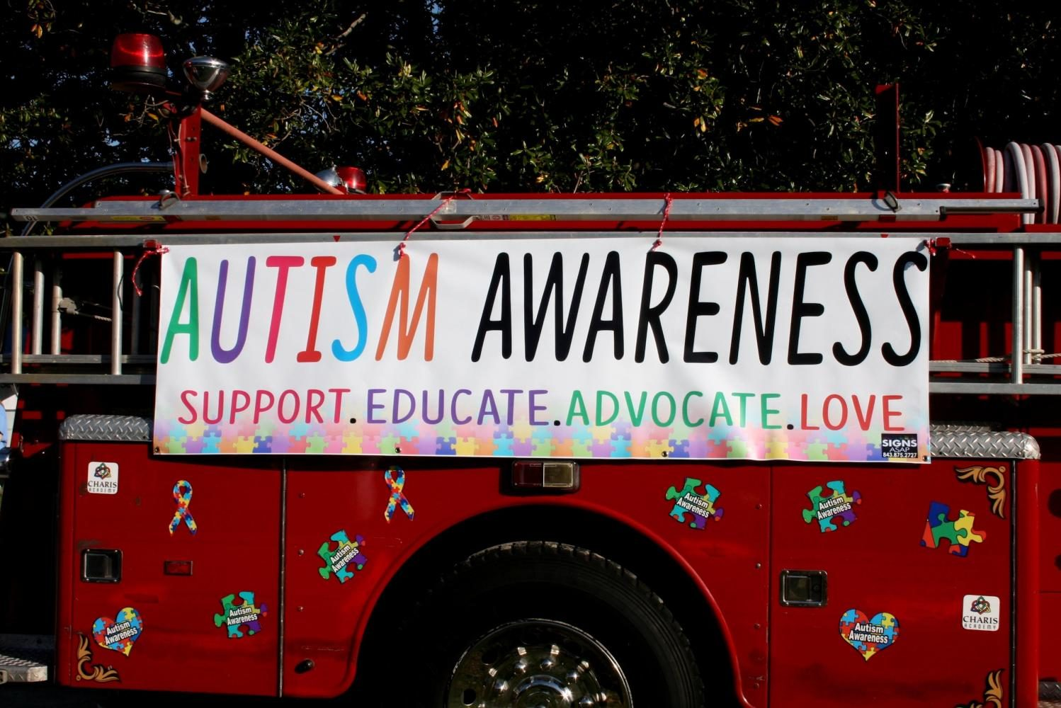 The Charleston Fire Department shows support for Autism Spectrum Disorders at the Charleston Autism Awareness Walk downtown at Marion Square on April 15.