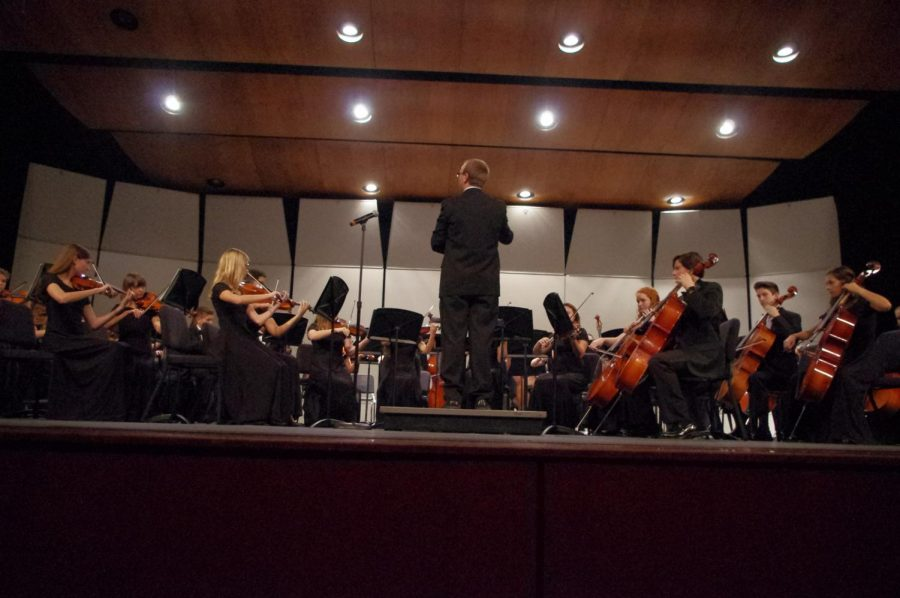 Ryan Silvestri (middle), one of the Wando Orchestra teachers, leading the Concert Orchestra at their fall concert on 10/17