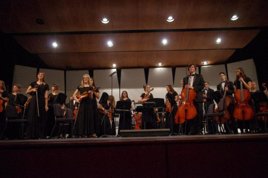 Concert Orchestra stands for applause at the end of their last song at the fall concert on 10/17