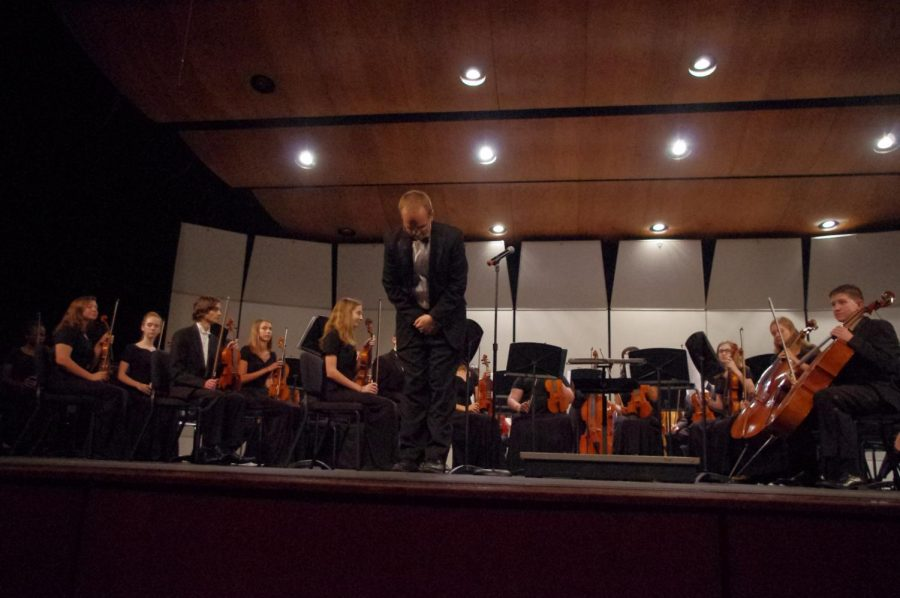 One of the Orchestra teachers, Ryan Silvestri, bowing to the crowd after a performance by the Chamber Orchestra at the fall concert on 10/17