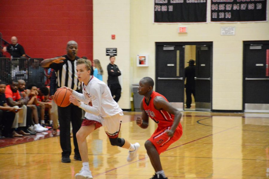 Vance Lupton (senior) dribbles around defender