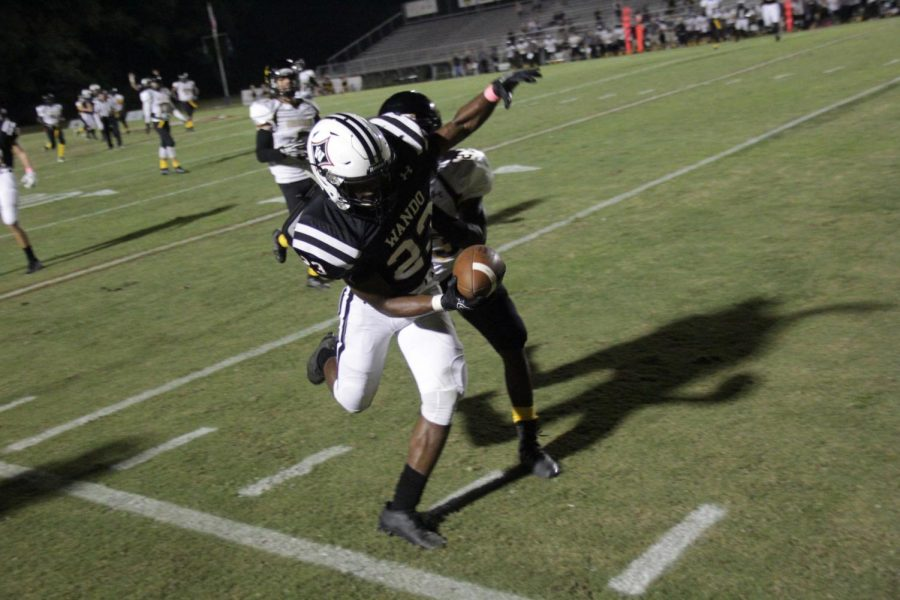 Senior wide receiver Noah Jenkins has a great catch during the home game versus Goose Creek, Oct. 13.