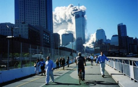 Smoke rises out of the twin towers after planes crashed into them.