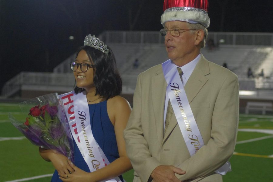 Naomi Sembiring and Kellen Noonan, through his Grandfather, pose as homecoming Queen and King
