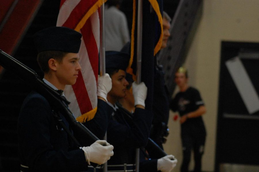 Mathew Rothkopf aids in the presentation of the colors.