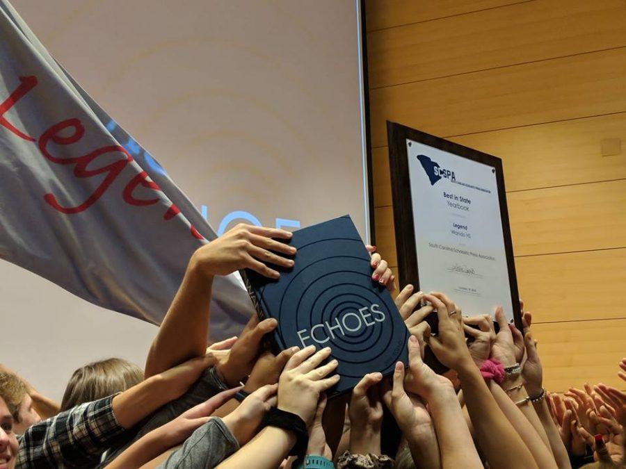 Legend yearbook holds up their winning volume