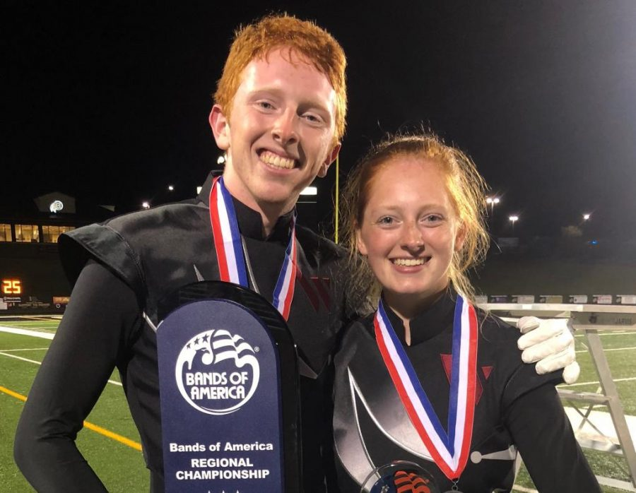 AJ+and+Anna+Johnston+hold+the+1st+place+trophy+that+was+awarded+to+Wando+Band.+