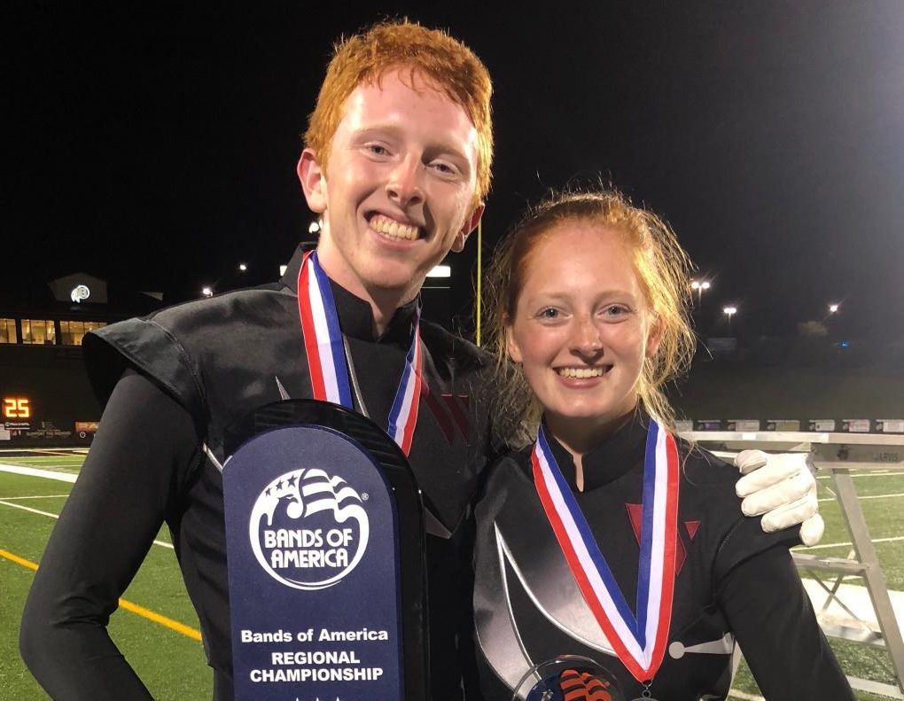 AJ and Anna Johnston hold the 1st place trophy that was awarded to Wando Band.