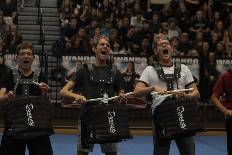 Jim Wilborn, Tim Haigh, and Matt Ianuzzi show off their talent at the fall pep rally