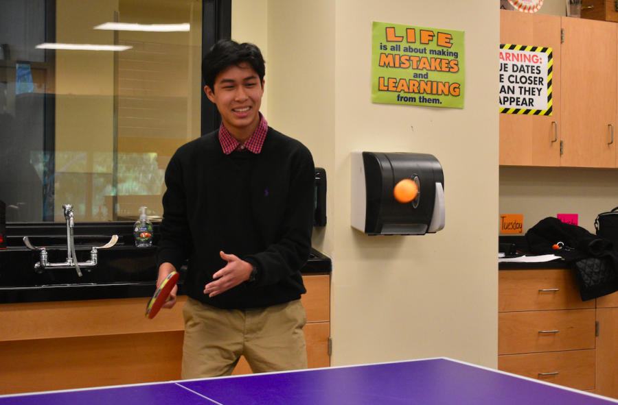 Andrew Nguyen plays a game of ping pong before school starts.