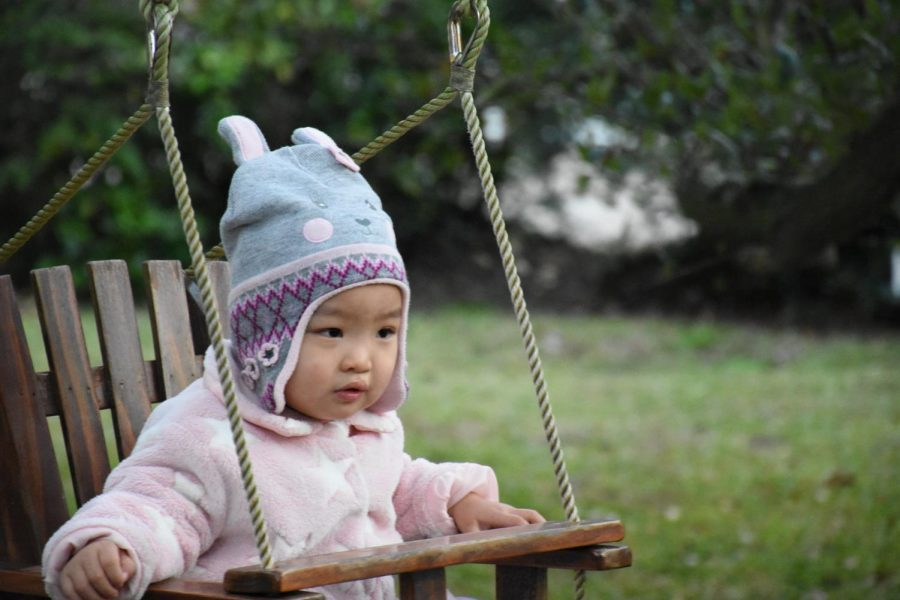 Despite the challenges Addy Meyers experiences, she still enjoys sitting in the swing at her new home.
