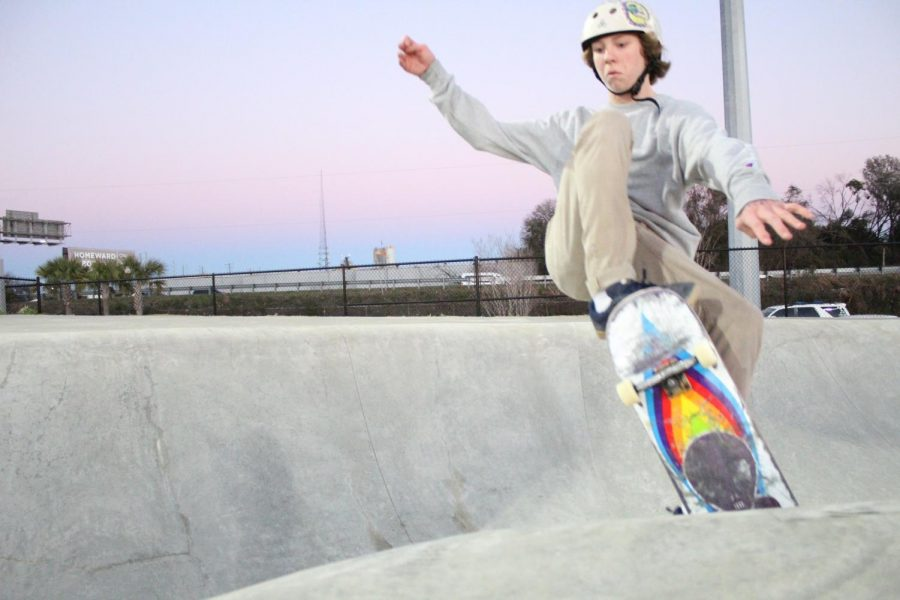 Sophomore Conor Kerr prepares for a dismount after he skates off the side of the bowl at the SK8 Charleston Skateboard park on Jan. 24.