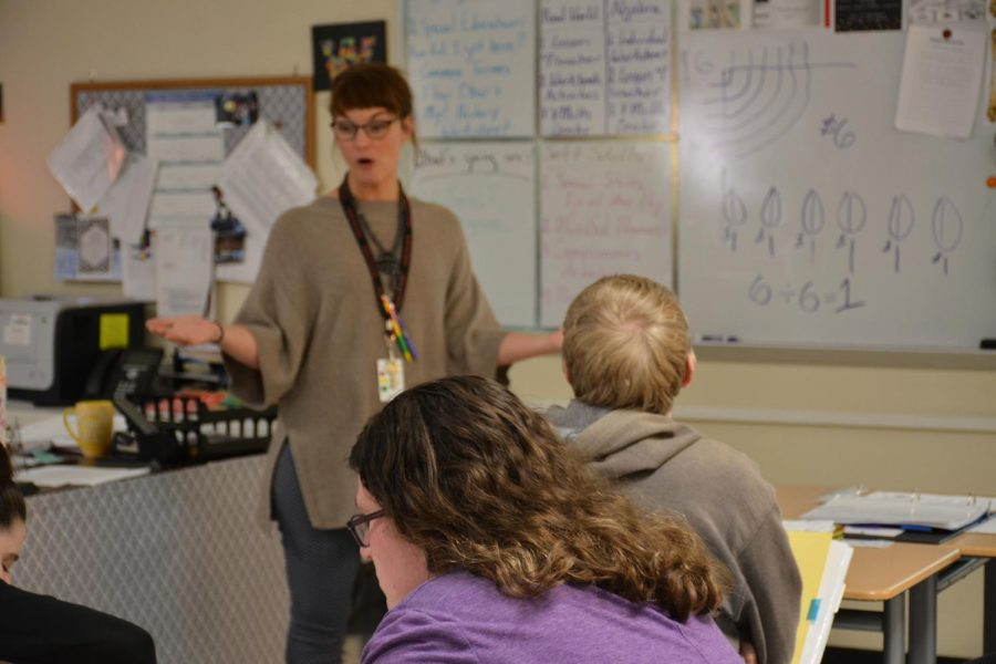 Mrs. Carr teaches lessons to her students.