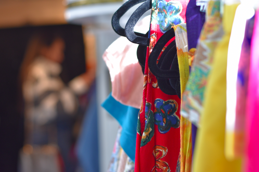 Rose's wide range of vintage styles and fabrics hang from the racks of the RV based store.