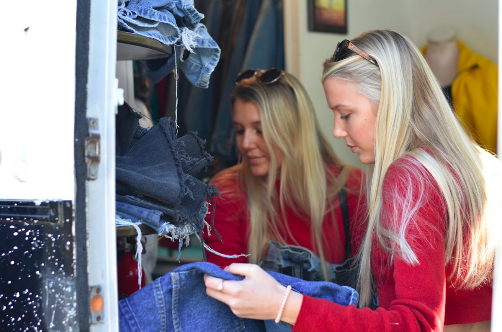 Junior Lila Mack and sister Allie Mack shop at Red Rose Vintage on Jan. 26 for denim shorts before grabbing a bite to eat at the nearby cafe.
