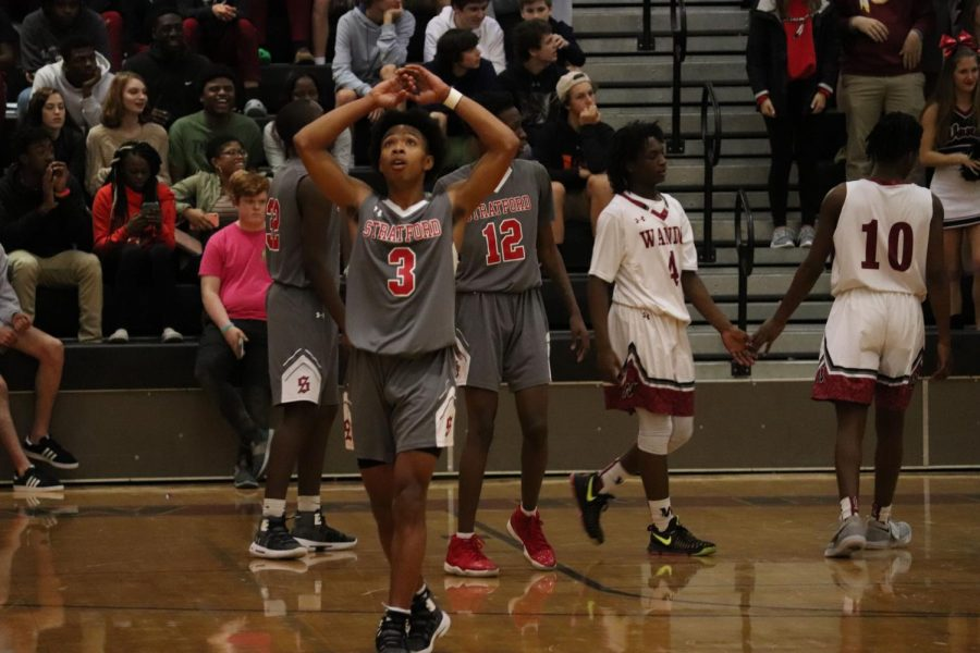 Senior Hassan Doiley for the Stratford Knights walks off in frustration being defeated 54-47 on Jan. 29.