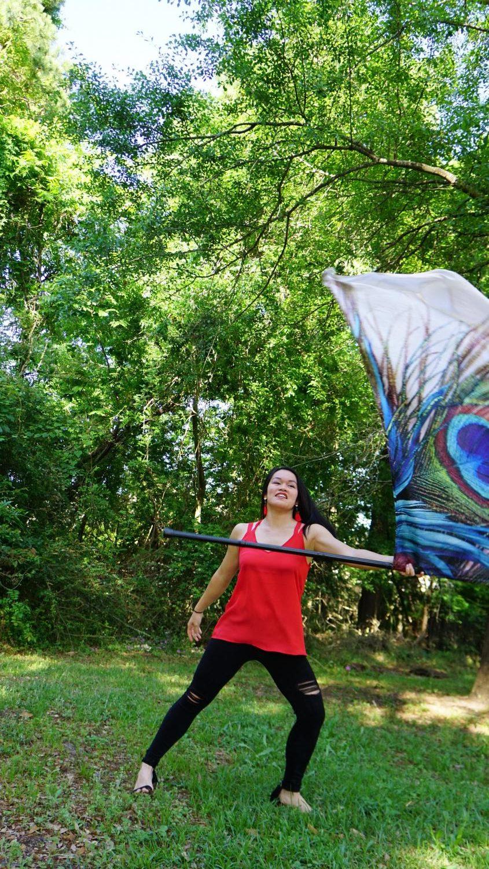 Grace Jaroscak performing a color guard routine.