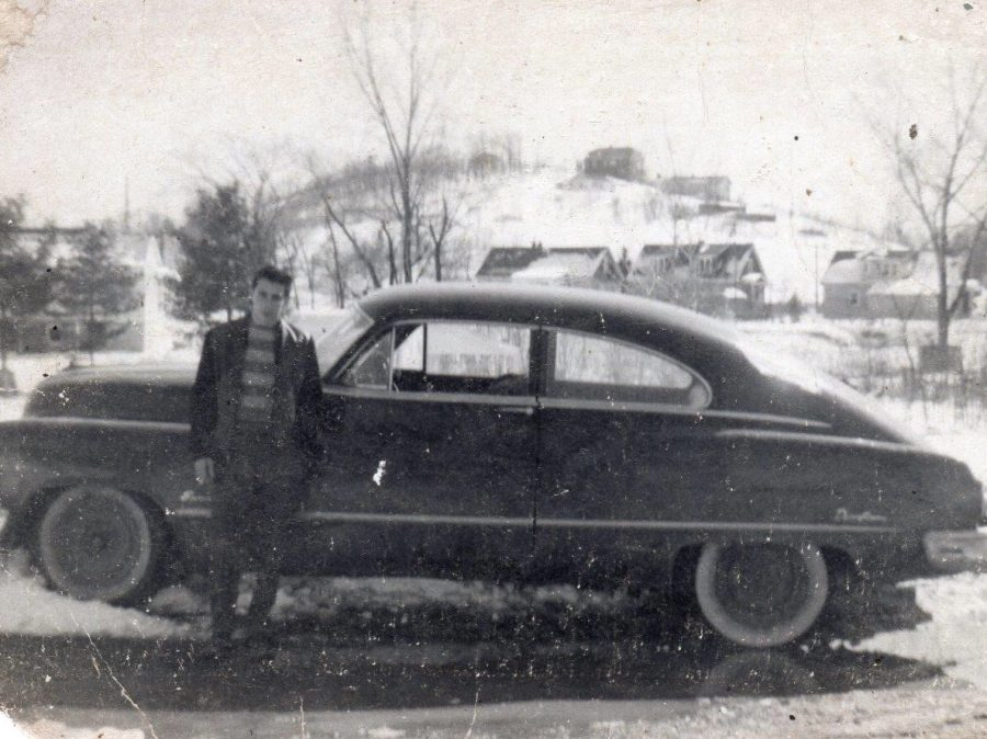 Jack Ciccarelli stands next to his 1951 Buick at age 18.