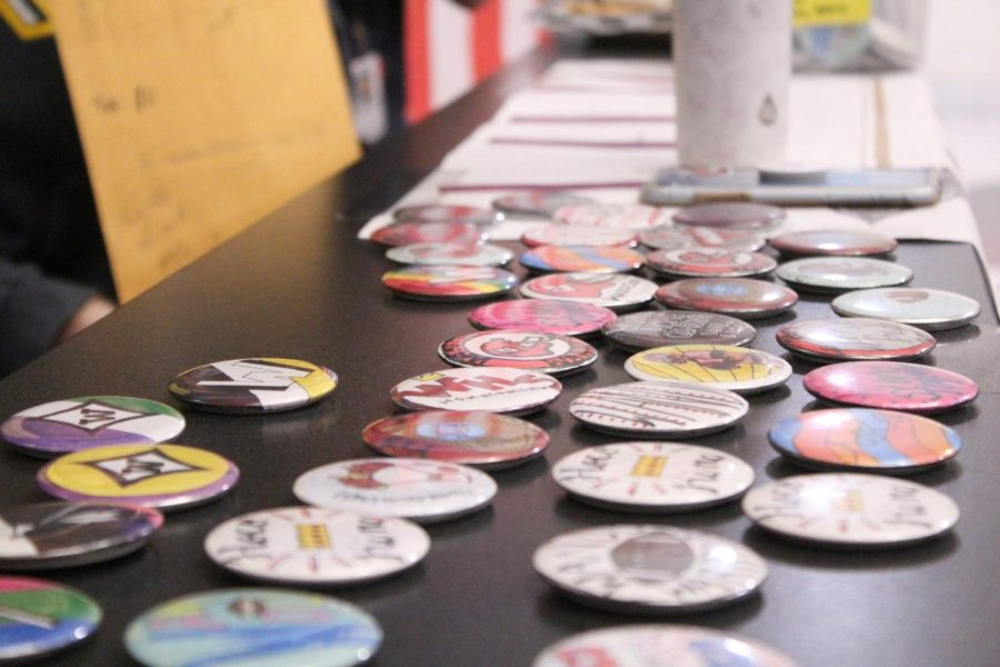 Buttons are being made and sold by Art Club