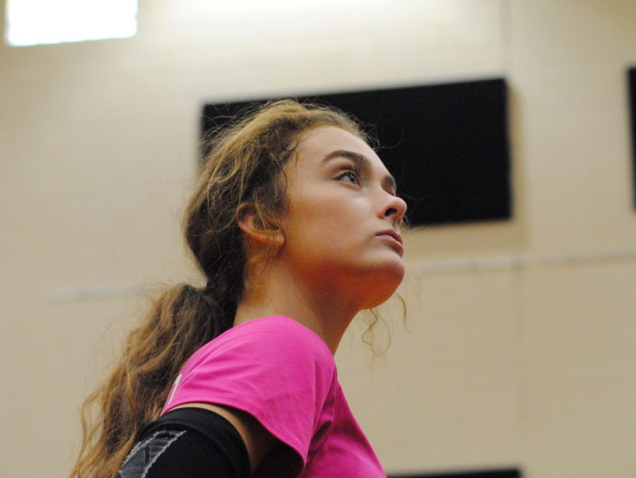 Senior Grae Gosnell scans the court between sets.