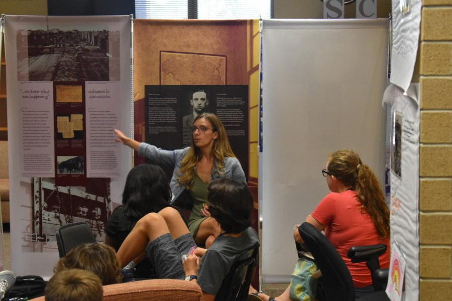 S.C. Project Director Morgan Bailey teaches students how to be docents for the Anne Frank exhibit.