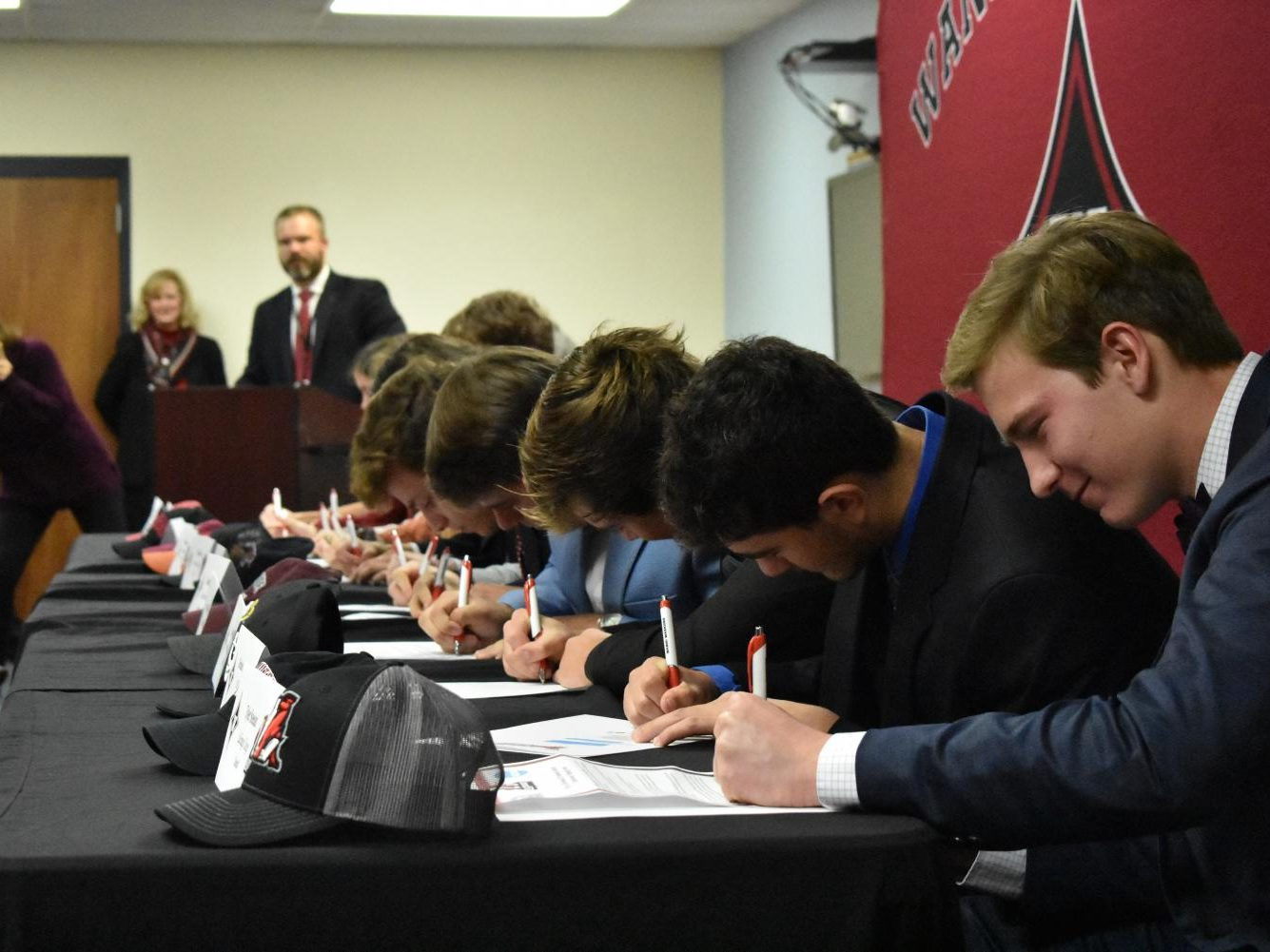 Student athletes sign to colleges on National Signing Day