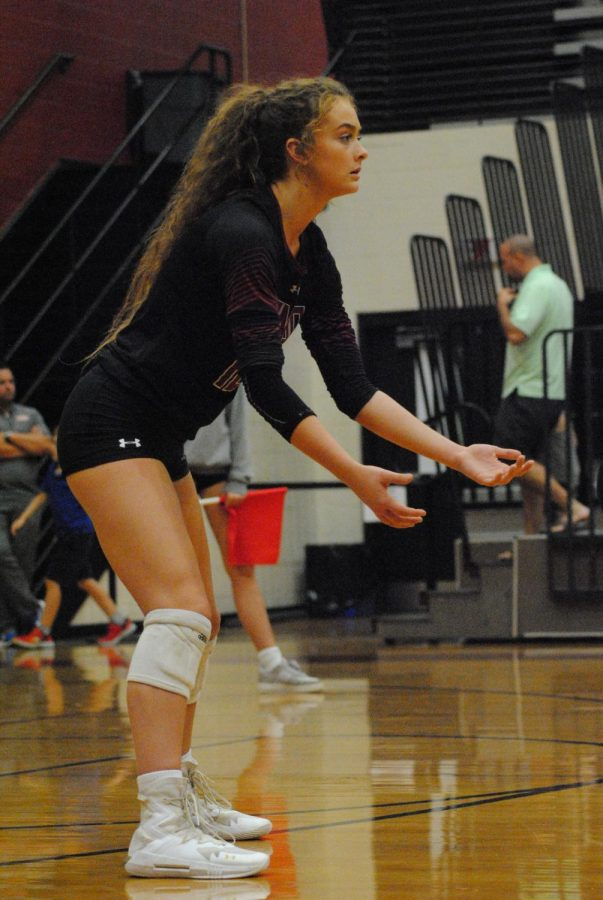 Senior Grae Gosnell preparing to hit back volleyball back to the opposing team.