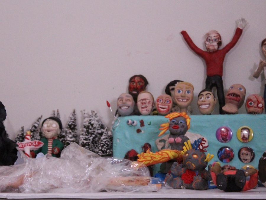Alumni Trent Shy's claymation figures lined up before filming.