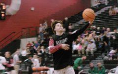 Boys varsity basketball falls to Bishop England