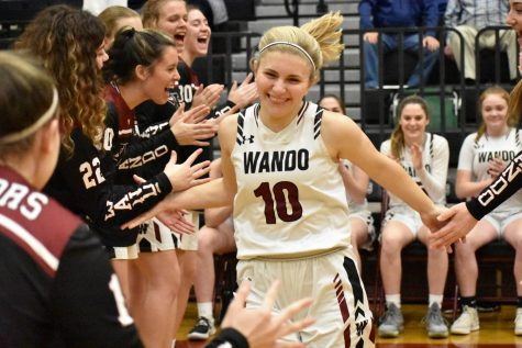 Senior Rena Marraccini is high fived by her teammates as she is introduced before the third-round playoff game on Feb. 24.