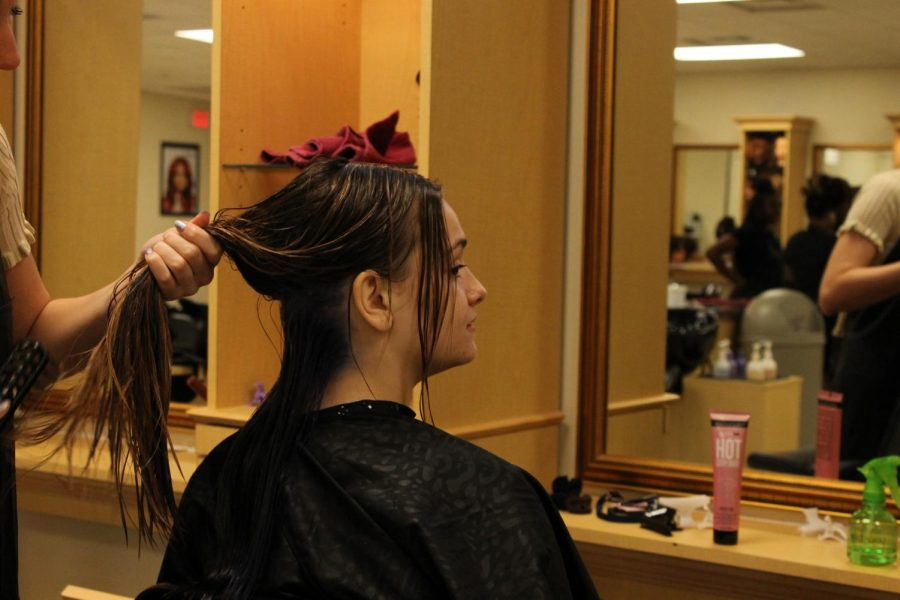 Junior Lindsey Hepburn gets her hair dyed in the Wando High School cosmetology classroom.