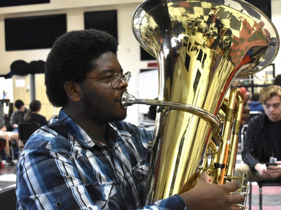 """Edward Smalls plays both the tuba and the bass for the Wando Band. He has been playing for 7 years and practices about 7 hours a week. On the tuba, his favorite song to play is """"Sweet Veronica"""" and on the bass he loves to play """"The Chicken"""" by Jaco Pastorius."""
