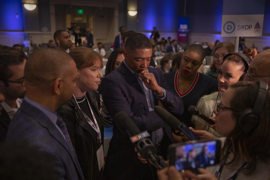 Joe Biden campaign team talking to reporters after the debate.