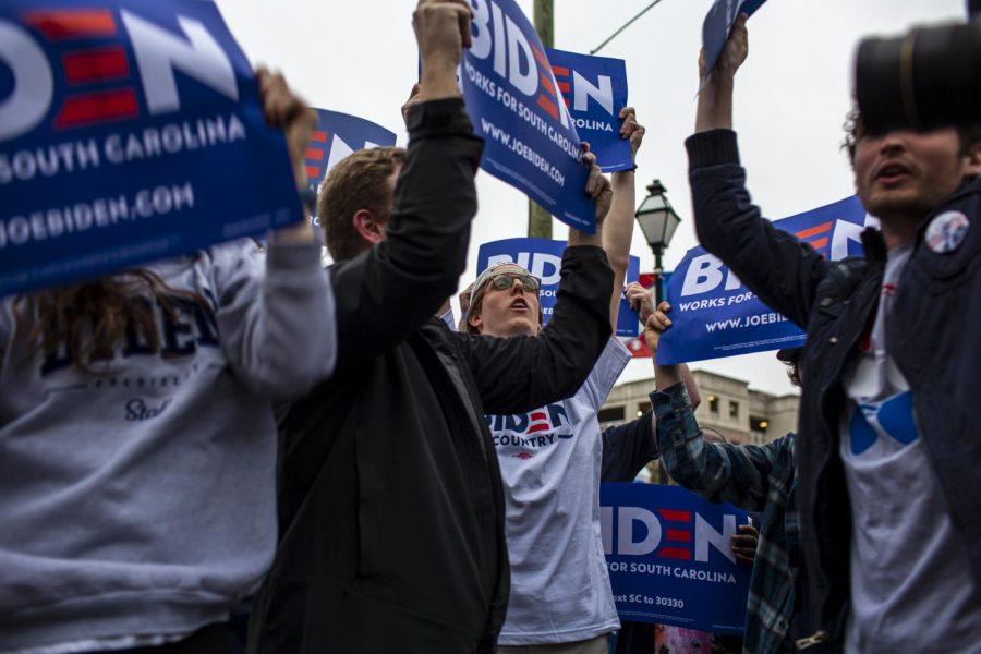 Joe Biden supporters chanting on the sidewalk outside the debate hall.