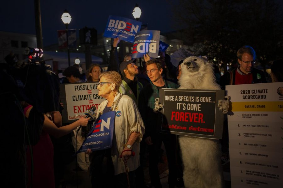 Joe Biden supporters and climate change activists speaking to local news station outside the debate hall.