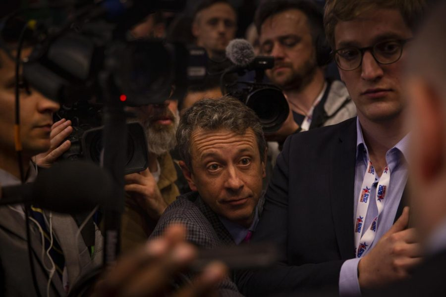 Reporters asking Michael Bloomberg campaign representatives questions in the spin room after the debate.
