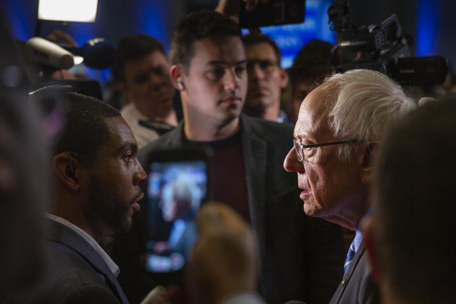 Presidential Candidate Bernie Sanders responding to questions after a television interview in the spin room after the debate.