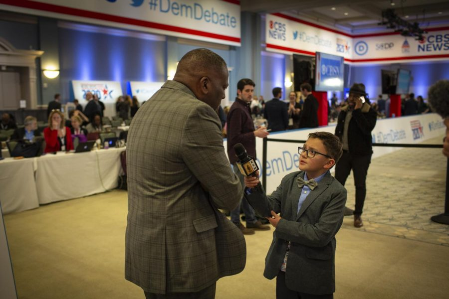 10 year old reporter for KidScoop Media Ethan Dumper interviewing campaign representatives in the spin room before the debate.