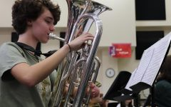 Junior Alyssa Gantenbein playing her euphonium during practice.