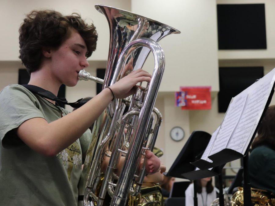 Junior Alyssa Gantenbein playing her euphonium during practice.