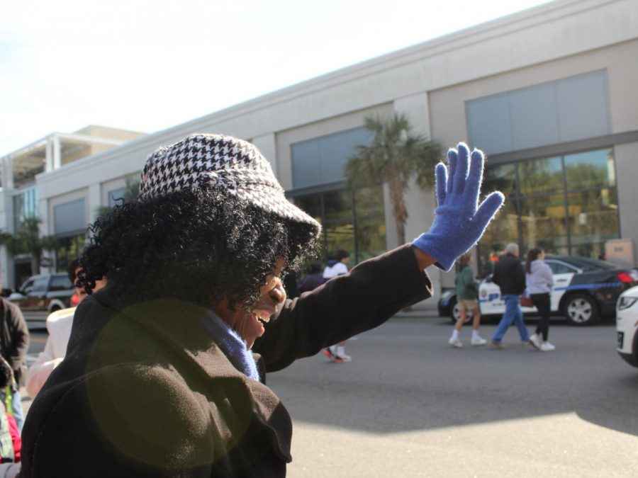 Ronnie Lanen waves as floats pass by at the Charleston Martin Luther King Day Parade.
