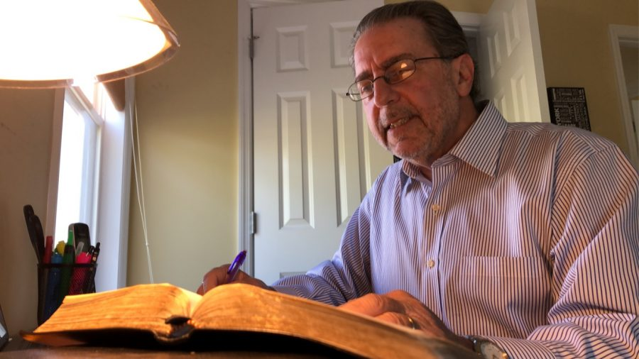 Mike Hipes writes notes in his study for his first Facebook Live sermon. He has been in ministry for 39 years, and preaches at Mt. Pleasant Church of Christ.