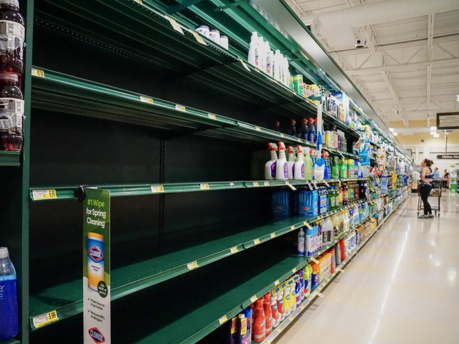 Shelves containing hand sanitizer and household cleaners were empty at Harris Teeter March 15.