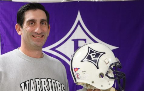 Health teacher Adrian Rocco explains that his favorite item in his room is a football helmet because