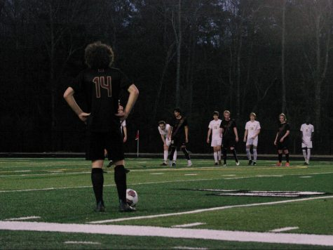 Sophomore Beckham Voelker prepares to kick the ball back into the game after a foul on Summerville.