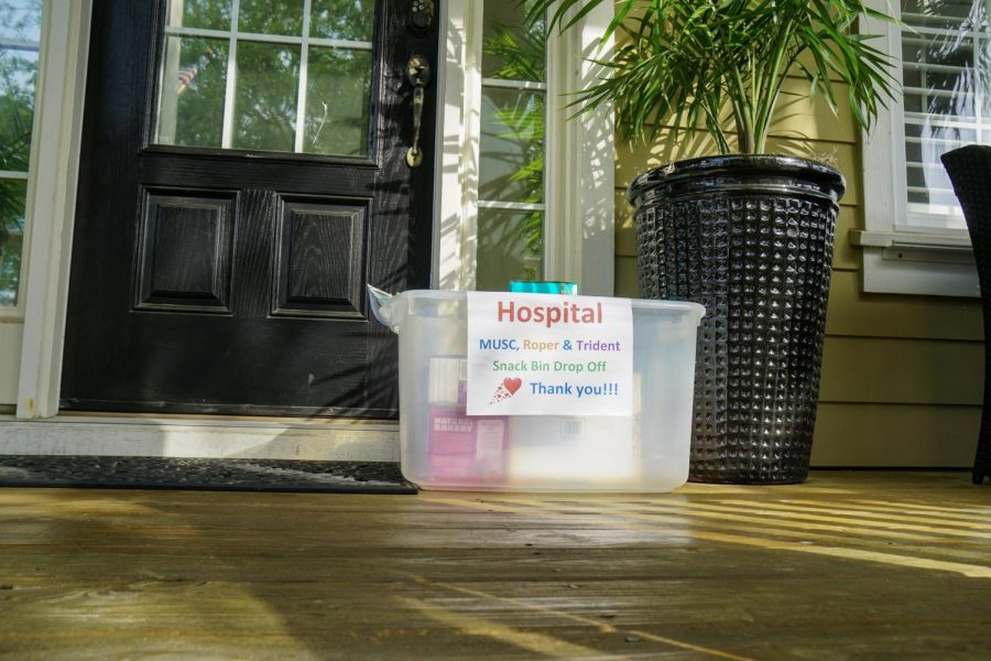 """A plastic bin holding snacks sits on the porch of Sandra Klein's house with a sign reading, """"MUSC, Roper & Trident Snack Bin Drop Off."""" Klein began collecting healthy snacks after finding inspiration through Facebook. The reach of Klein's snack campaign had expanded to East Cooper Medical Center in Mount Pleasant by March 28. """"I'm planning to just continue doing this now for a while and just kind of gauging where we are next week versus the next week,"""" Klein said."""