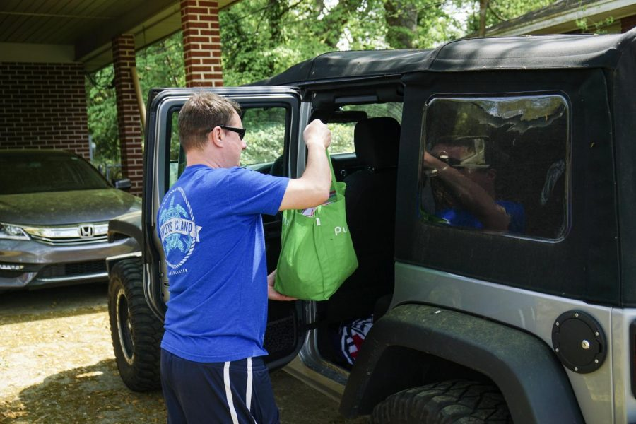 Intramed Plus nurse Brian Daigle loads donated snacks into his car to bring to MUSC Main Campus.