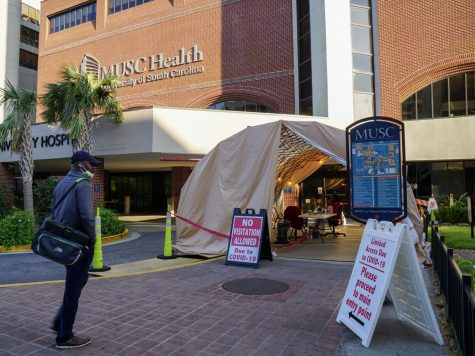 A man with a mask enters MUSC on March 2. A security checkpoint was set up in which visitors and workers alike must pass through to continue into the hospital.